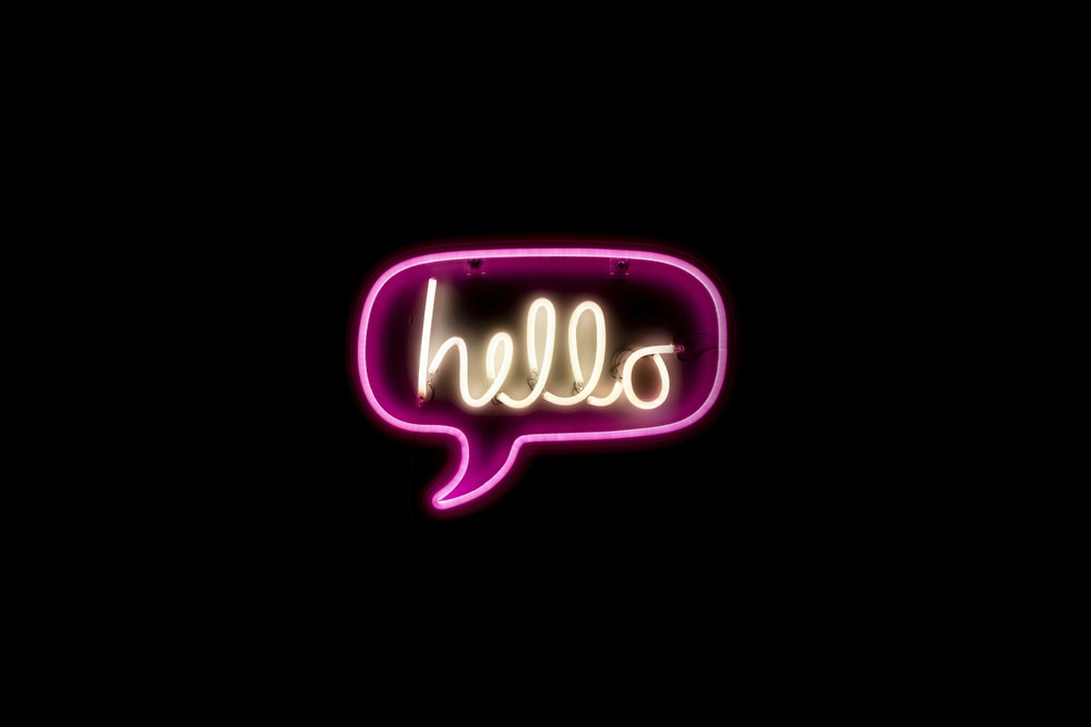 pink and yellow hello neon light