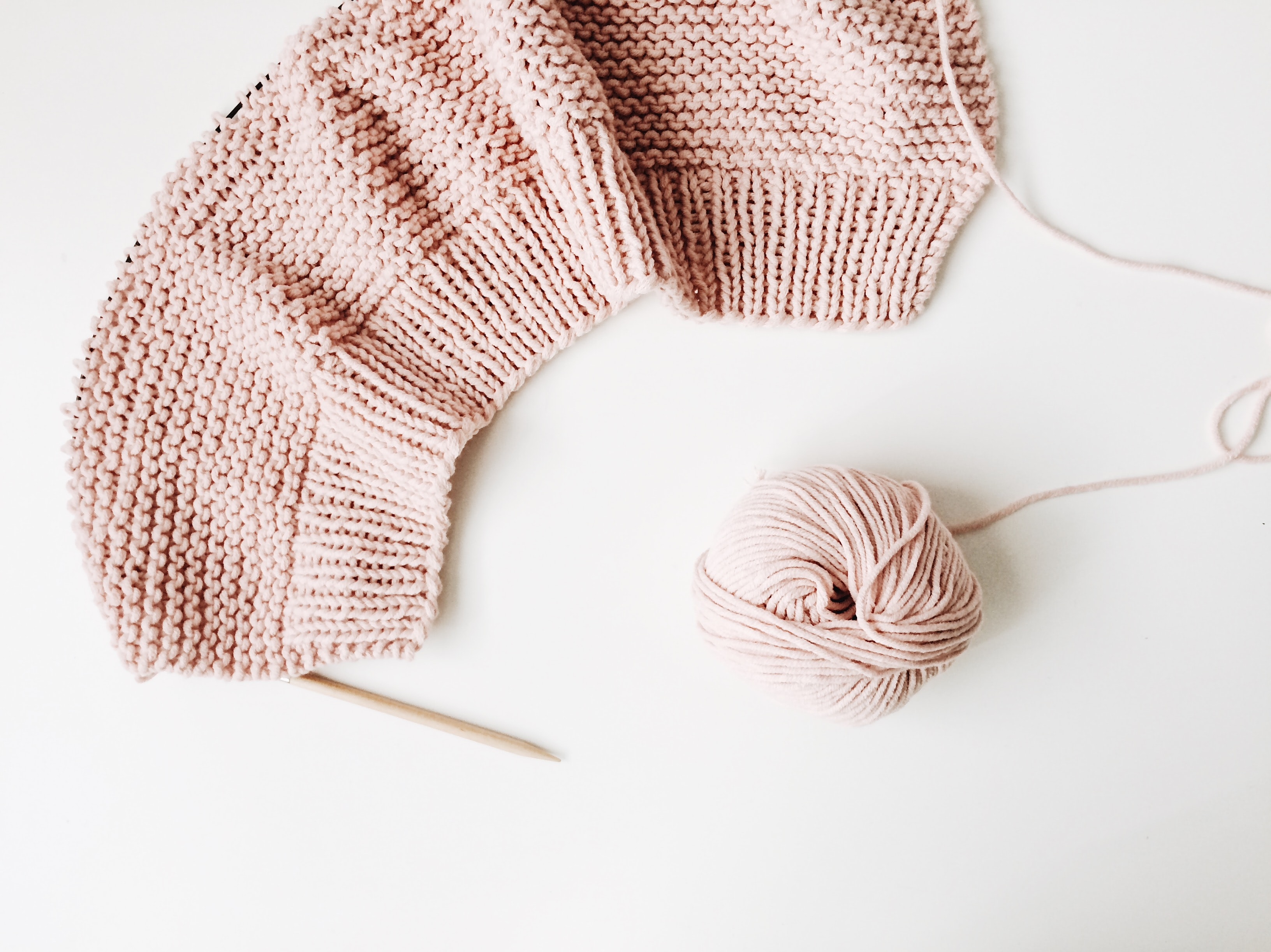 women's pink knitted sweater