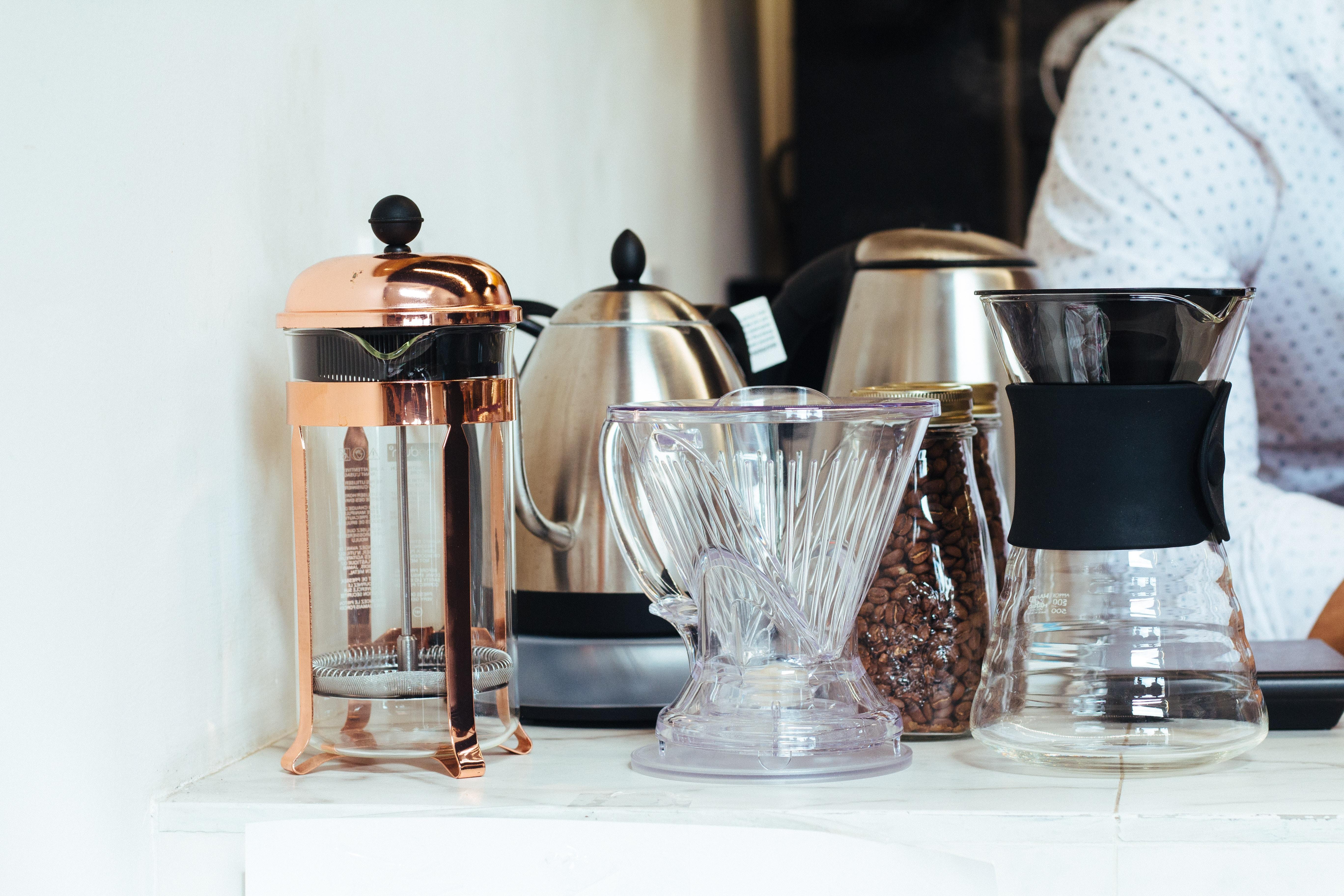 four coffee pots on white desk