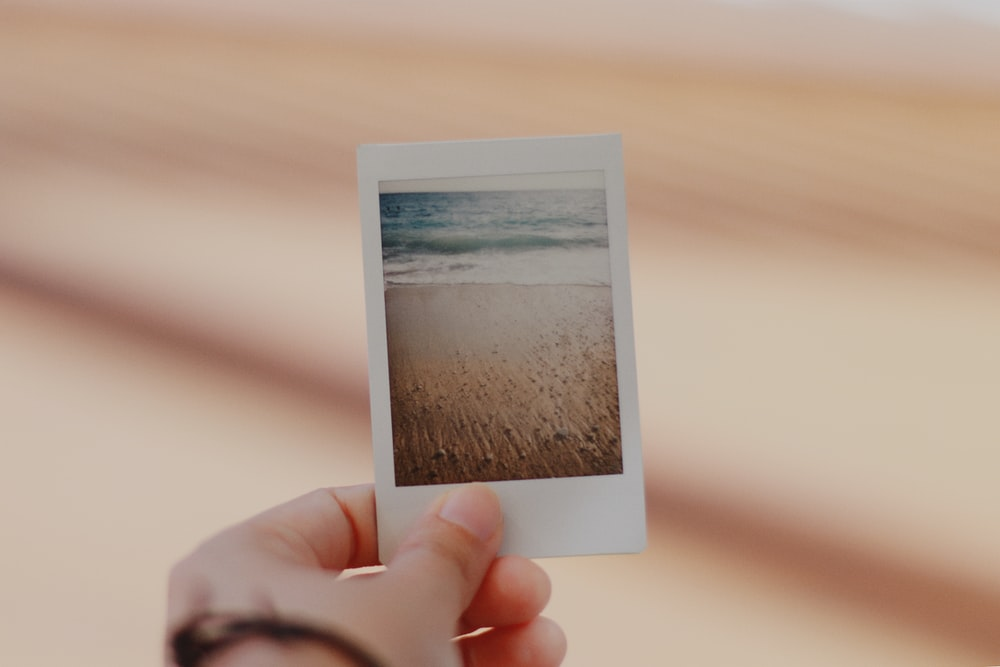 person holding film photo