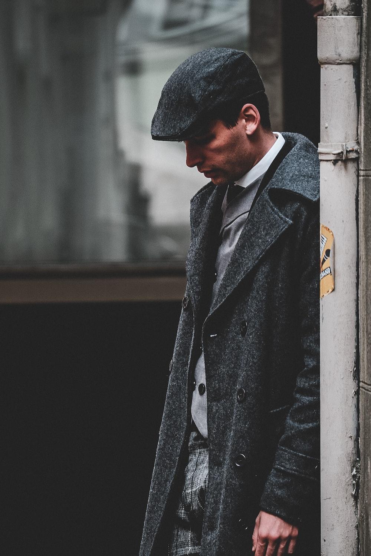 man wearing gray flat cap and coat