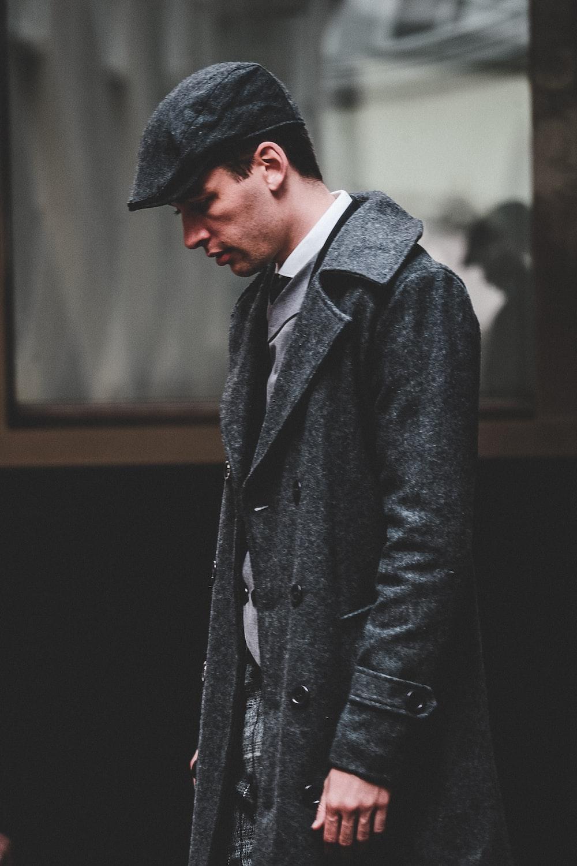 man wearing long coat