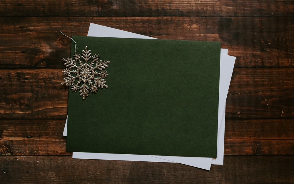 gray snowflake on green paper