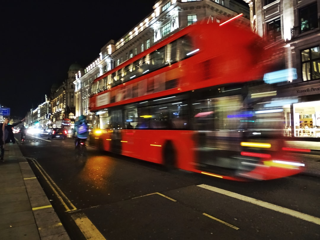 The speed  of the London bus speeding past the bus stop! I think I must have missed that bus. Photo taken in the busy London Street of a nighttime.