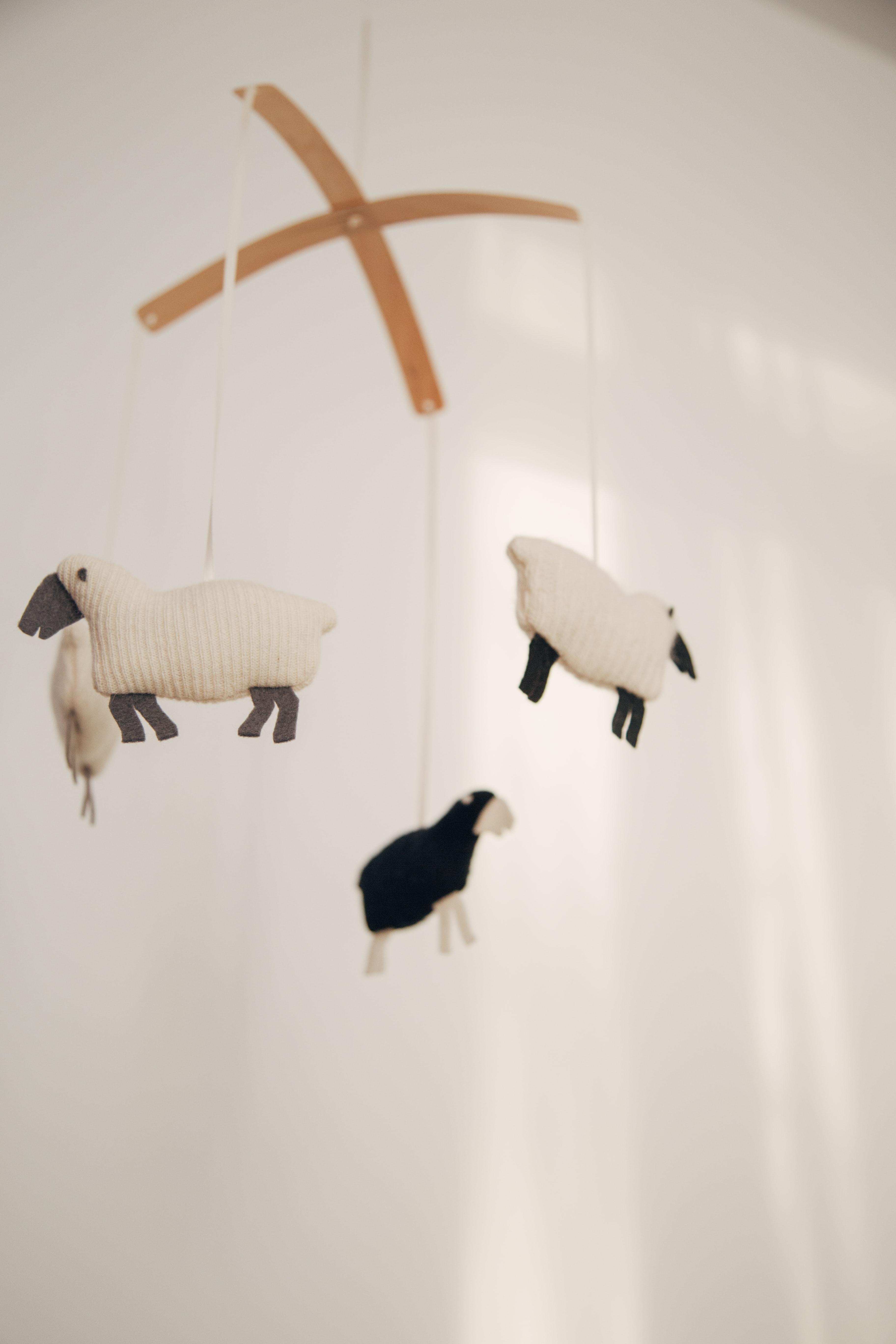 white sheep baby mobile