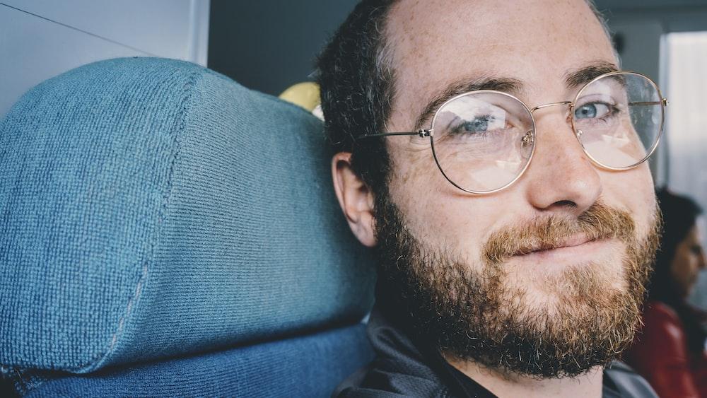 man wearing gold-colored eyeglasses