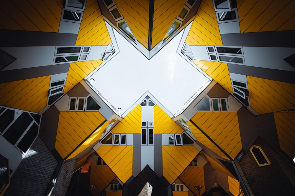 yellow and grey geometric buildings