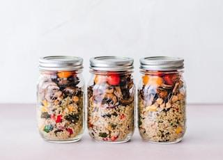 three full clear glass jars with lids
