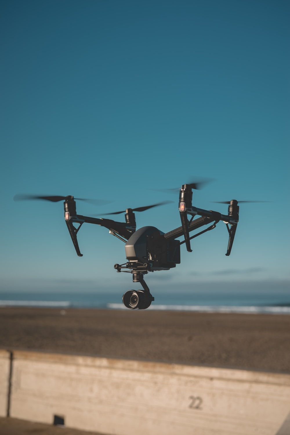 black quadcopter drone flying