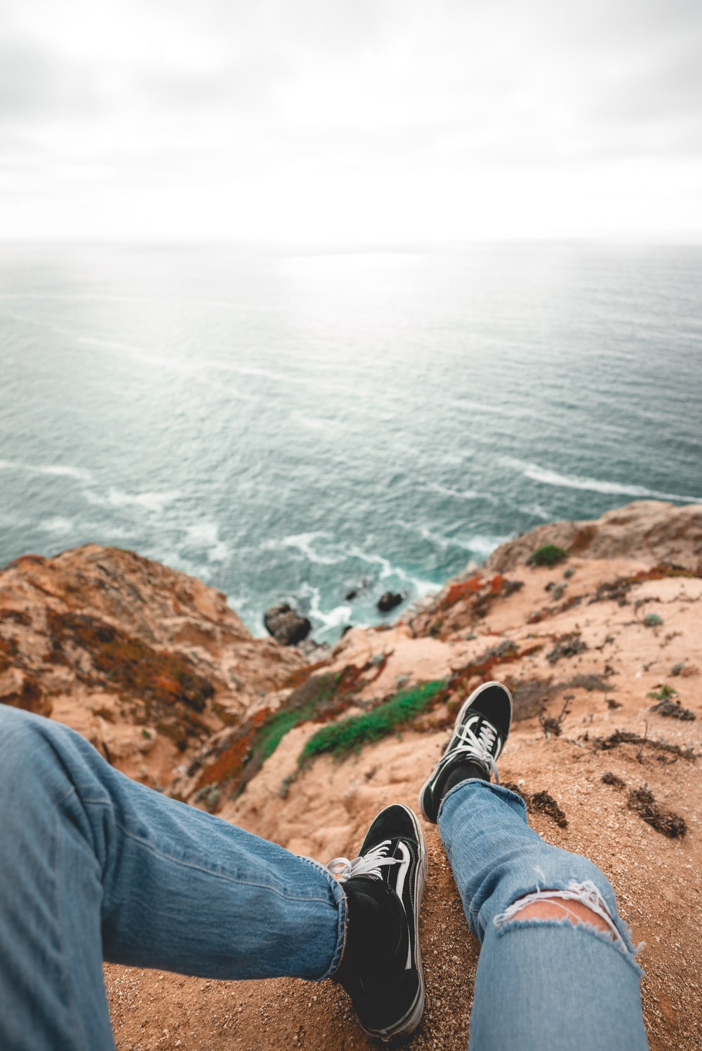 person sitting on rock formation