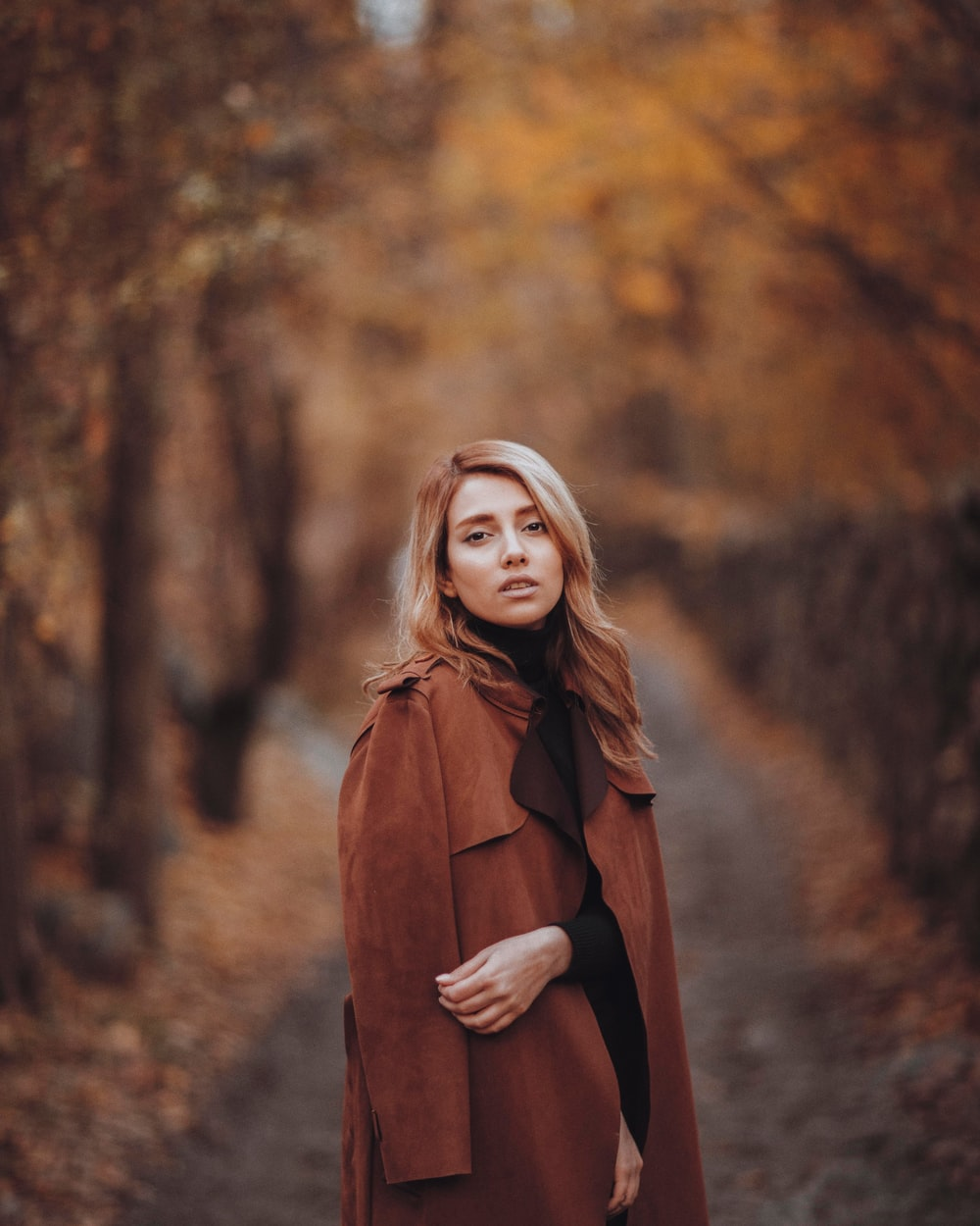 selective focus photography of woman wearing coat