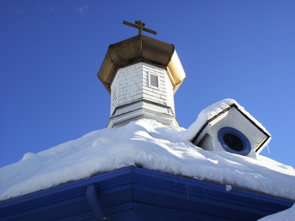low angle view photography of white and blue church