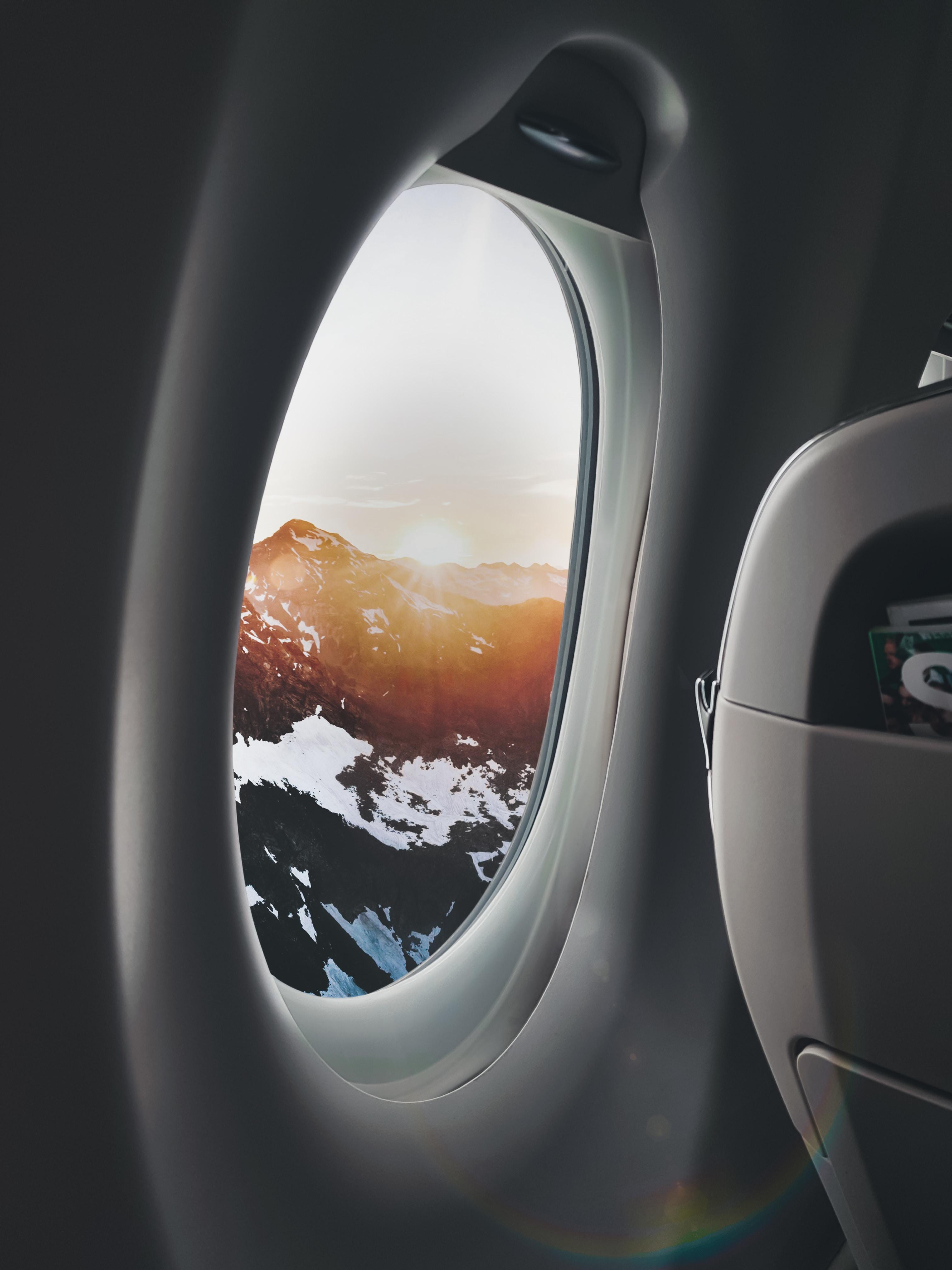 plane window showing mountain