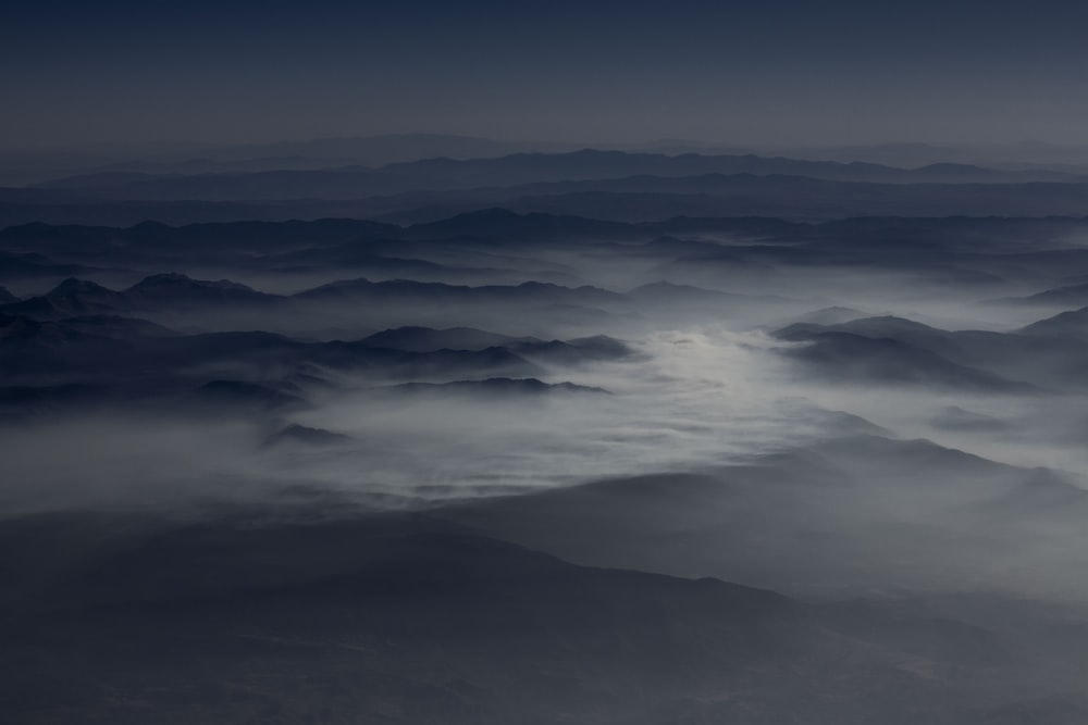 aerial photography of sea of clouds over mountains