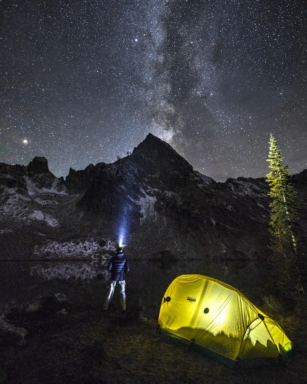 man standing near mountain at nighttime