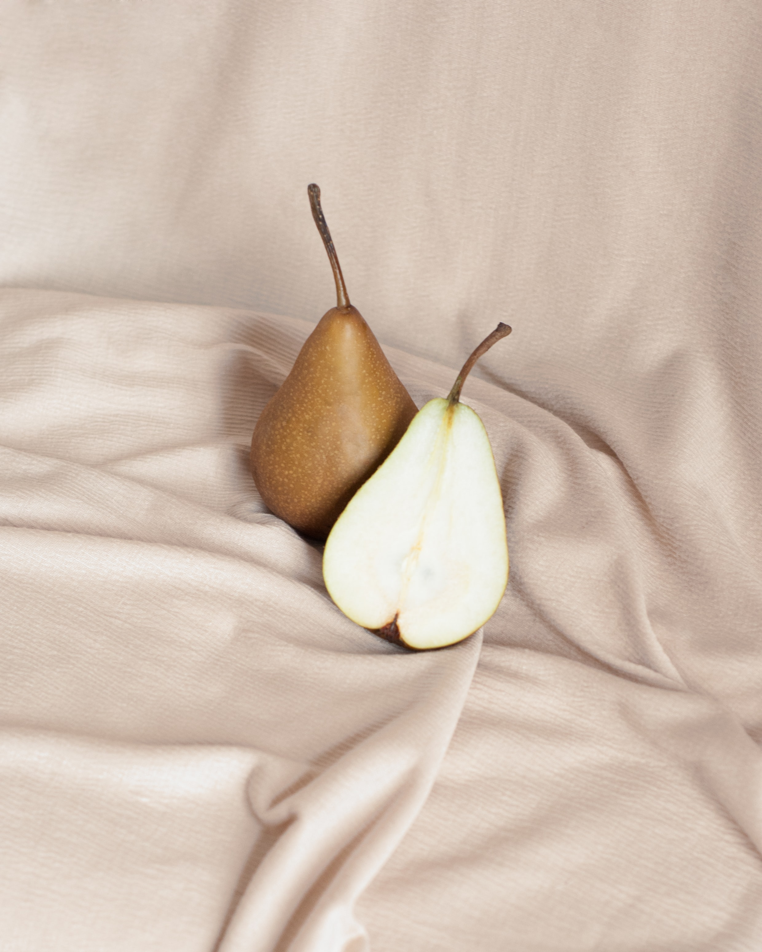 Two pears against a beige background