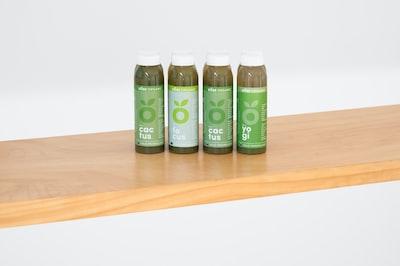 4 bottles of DOSE Juice on a shelf