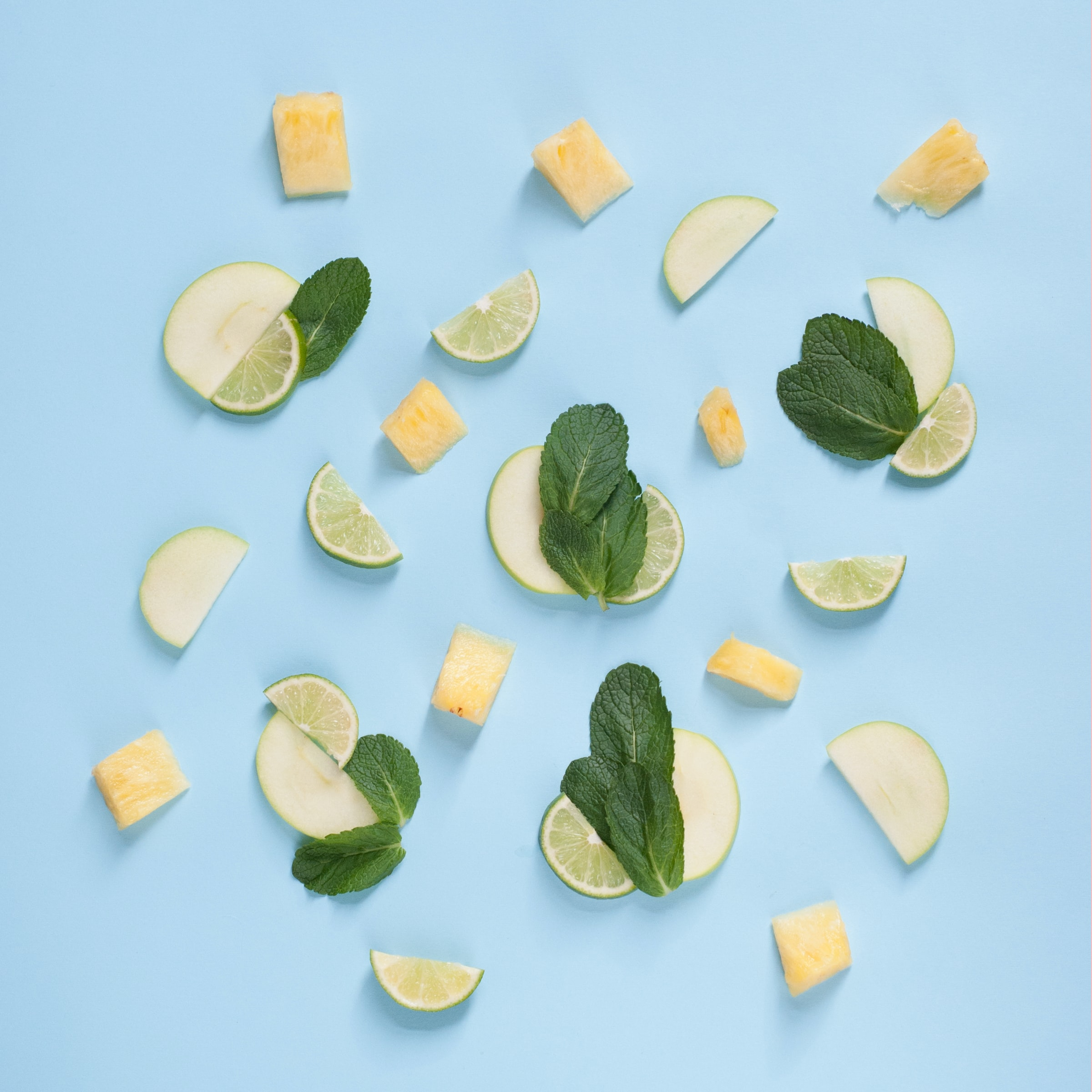 Slices of tropical fruit on a blue background