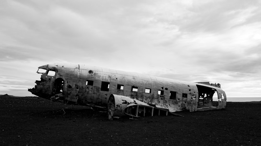 ruin white plane under grey clouds