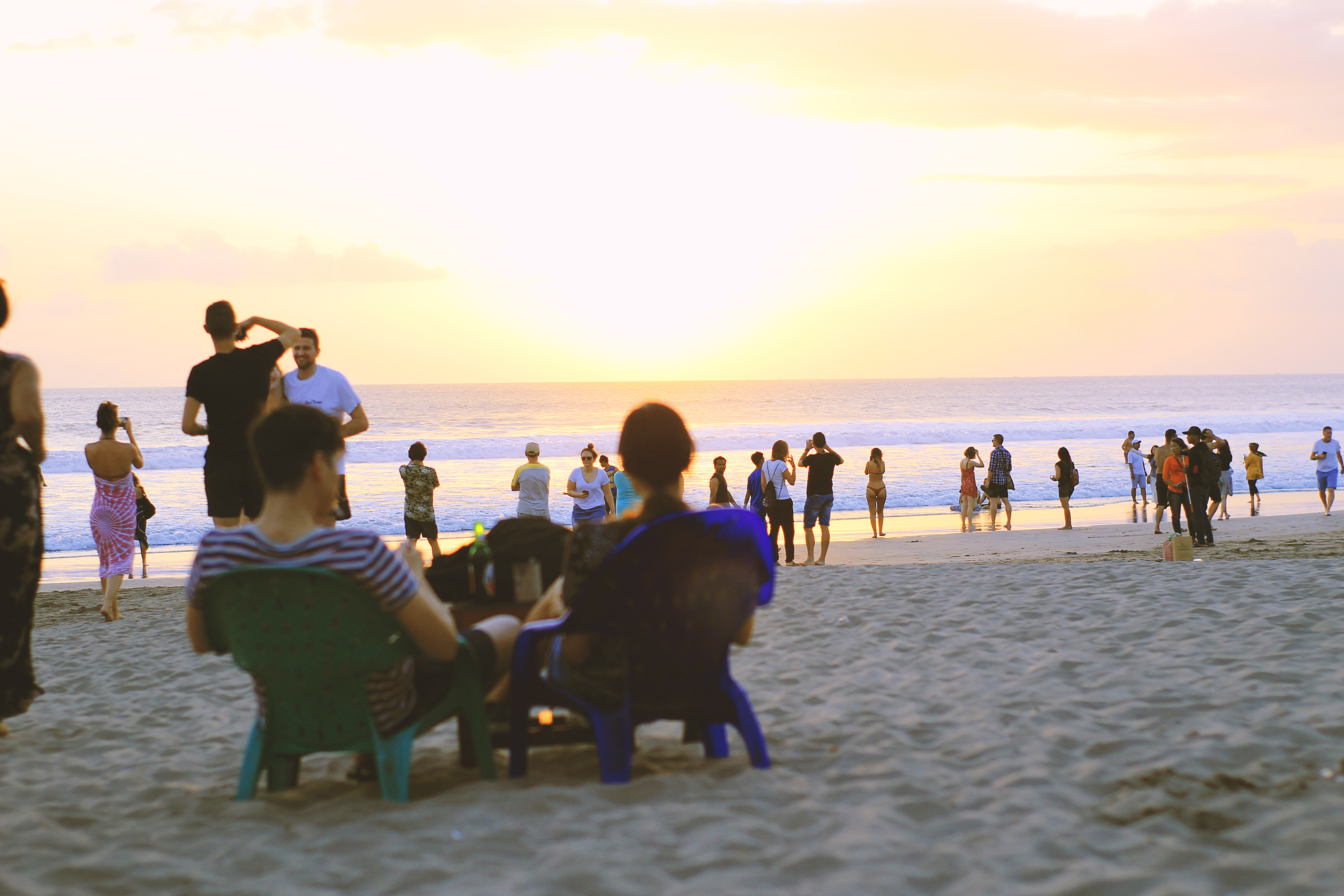 people on seashore during golden hour