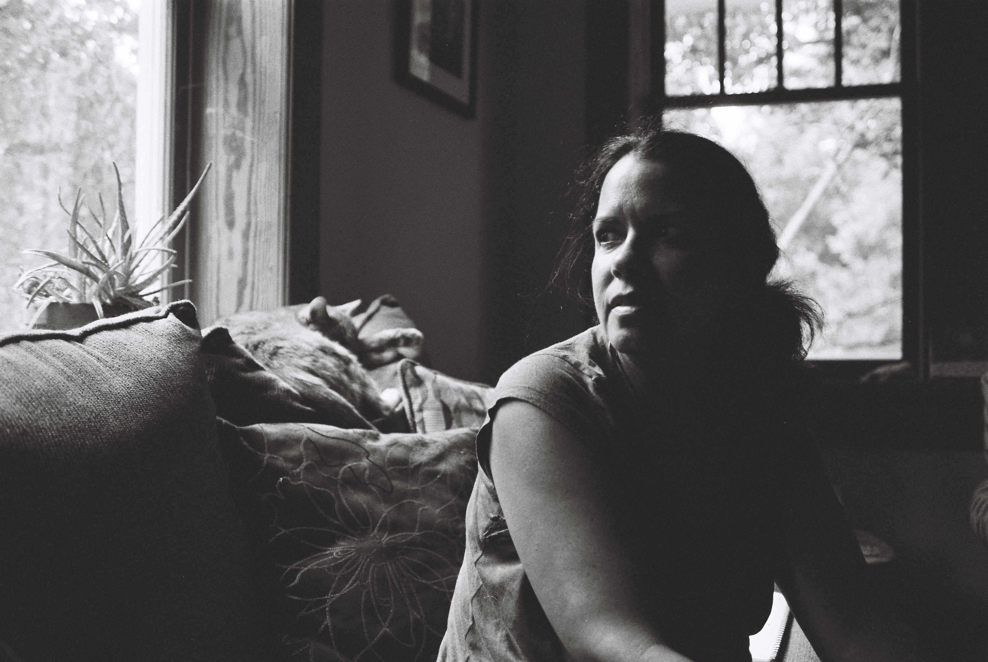 grayscale photography of woman inside room