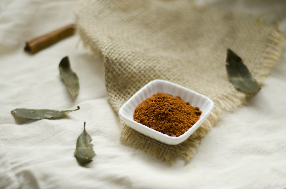 selective focus photography of a brown powder