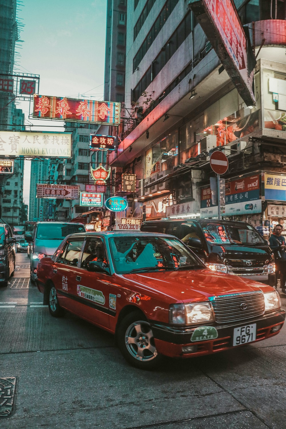red taxi cab on Hong Kong street