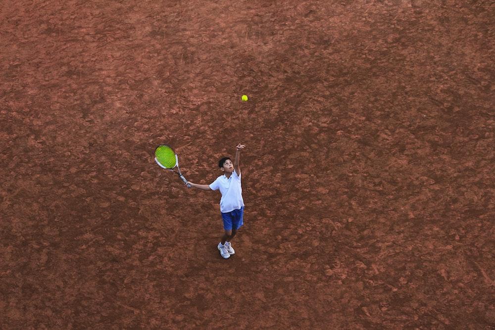 child holding racket