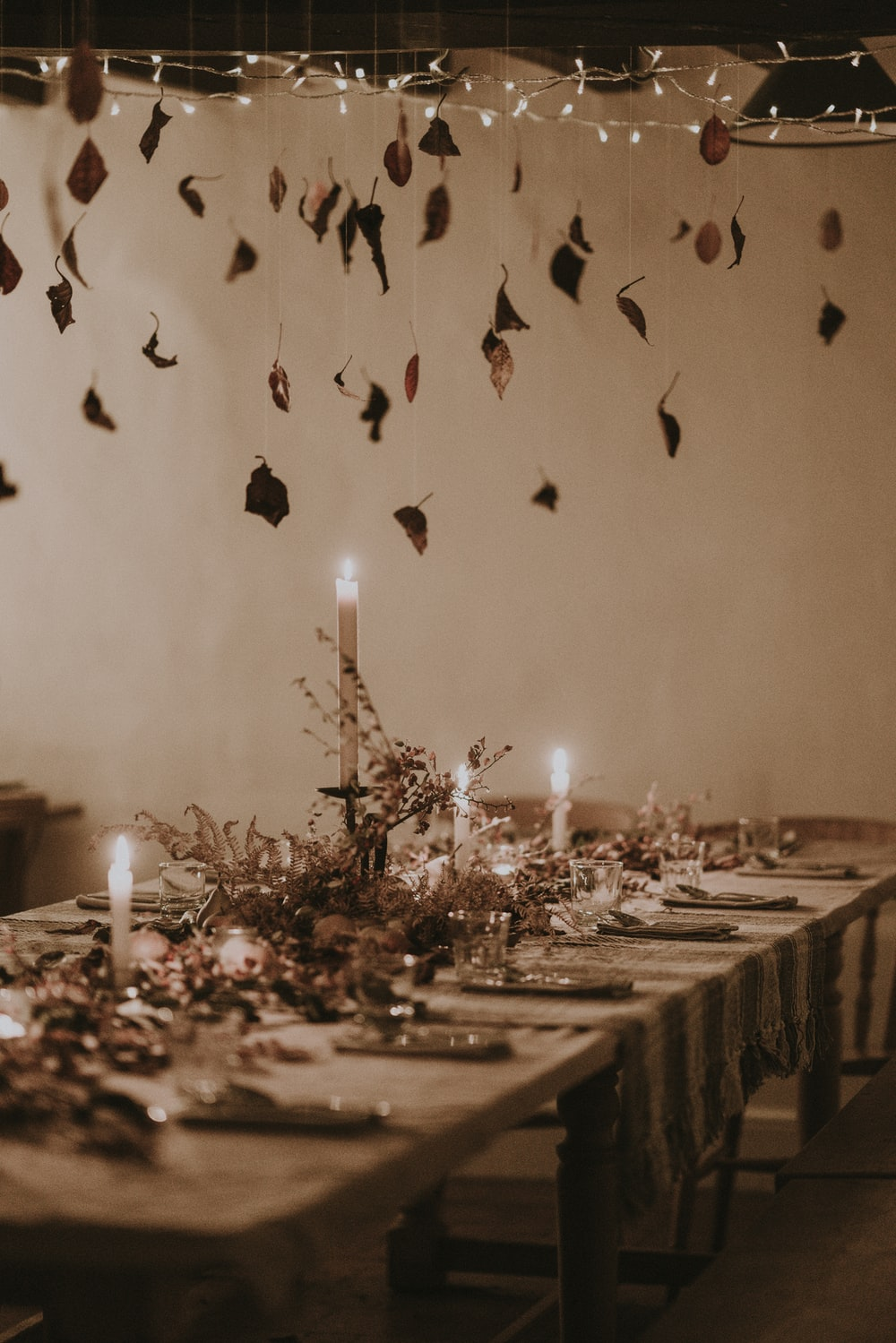 empty table and chairs with candles