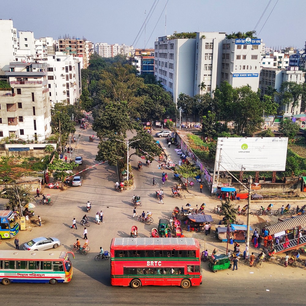 aerial photography of red bus on road