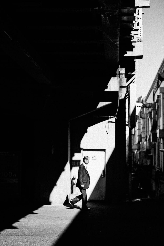 man standing beside door