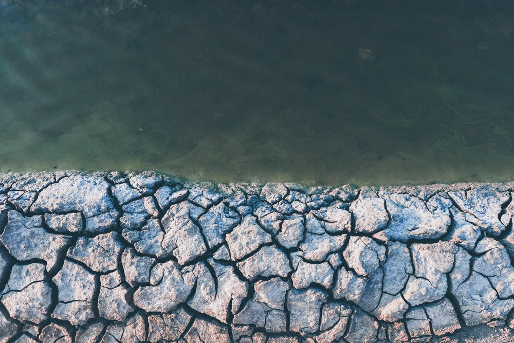 body of water near concrete surface during daytime