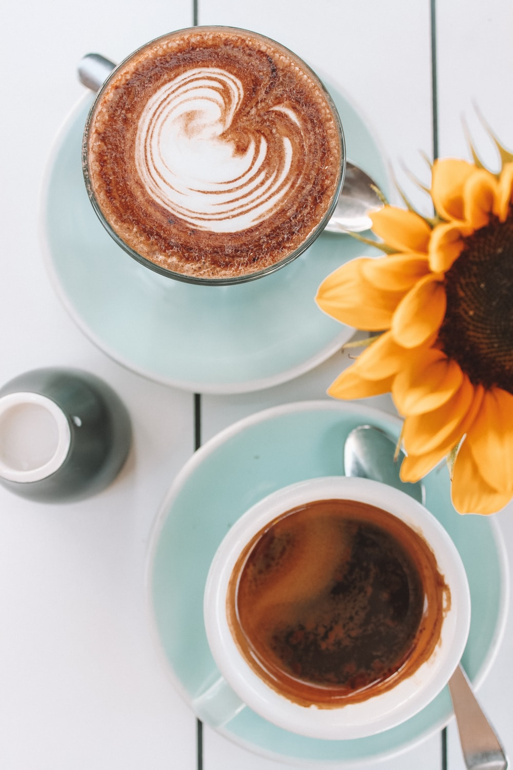 two cups filled with coffee