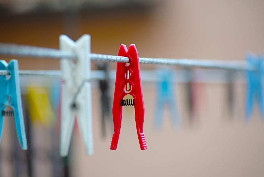 red plastic clothes peg