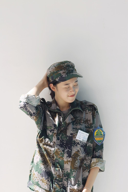 woman wearing camouflage uniform