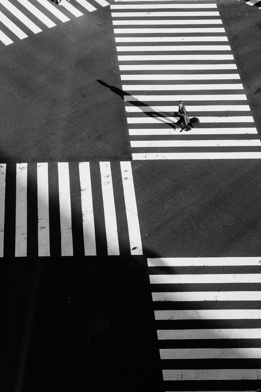 person crossing on pedestrian lane