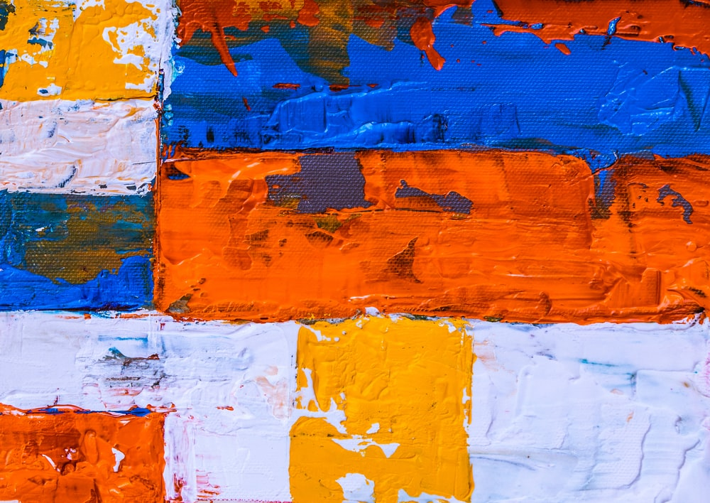 blue, orange, and yellow abstract painting