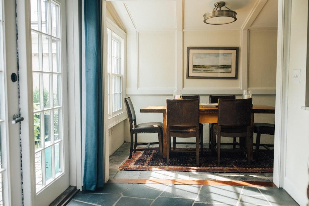 rectangular brown wooden dining table near door