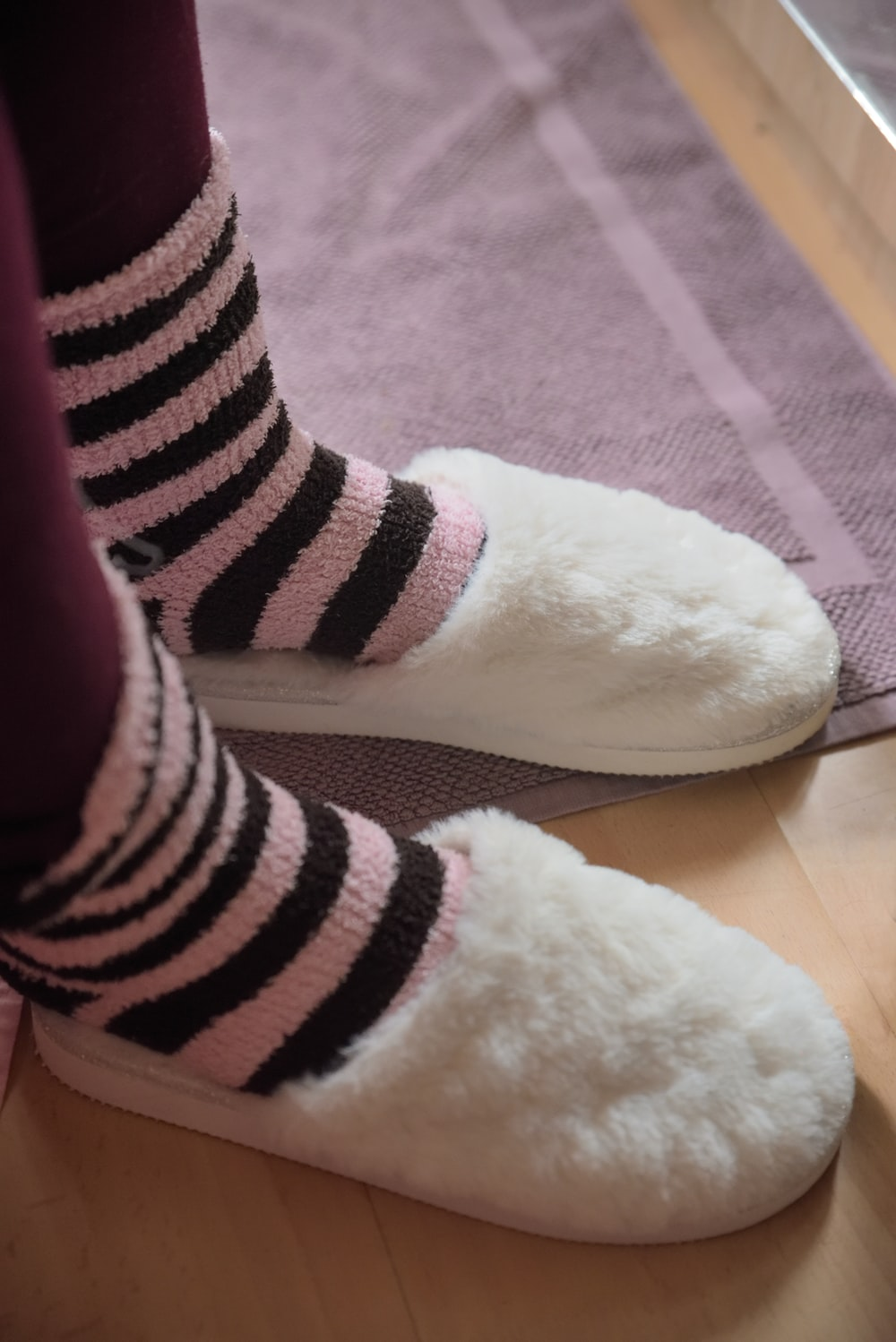 person wearing white bedroom slippers