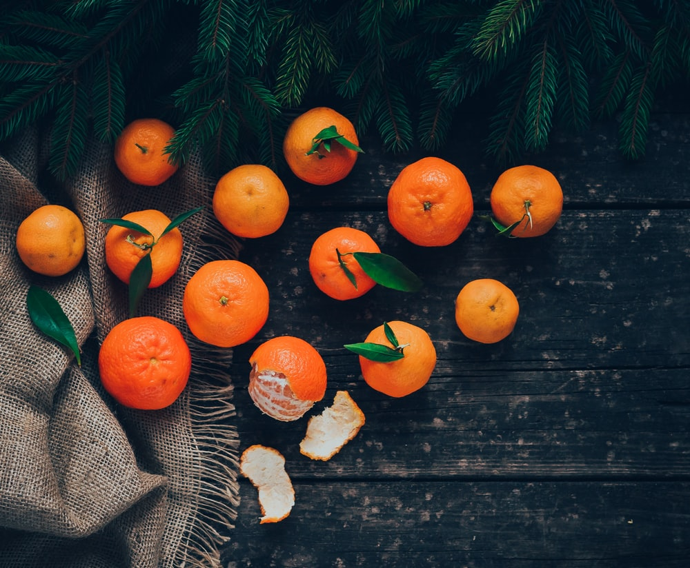 13 oranges on black textile