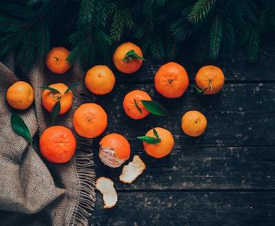 13 oranges on black textile jingle bells teams background