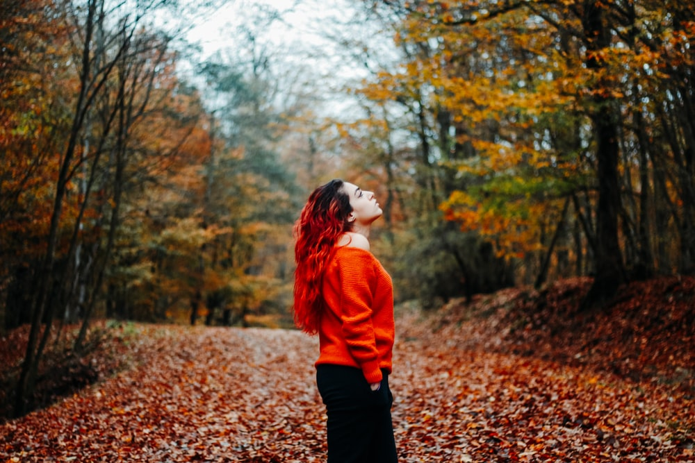 woman wearing orange sweater during daytime