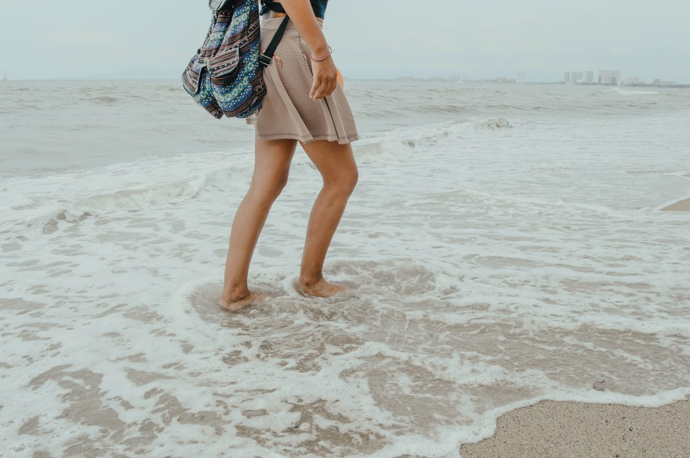 woman walking on seashore