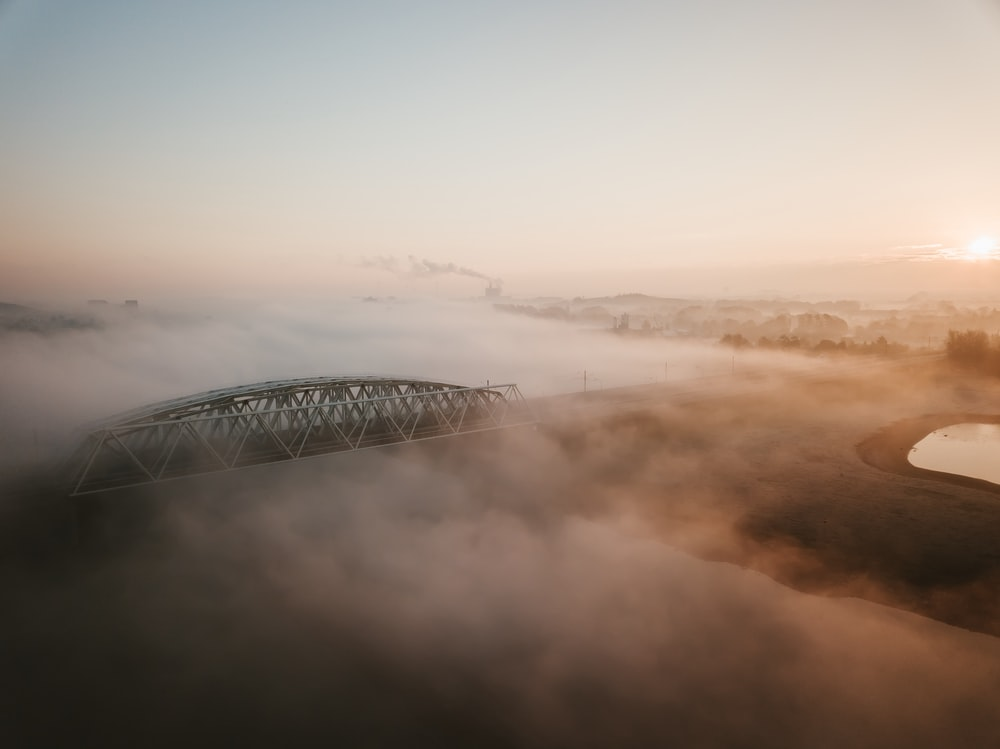 aerial photo of foggy bridge