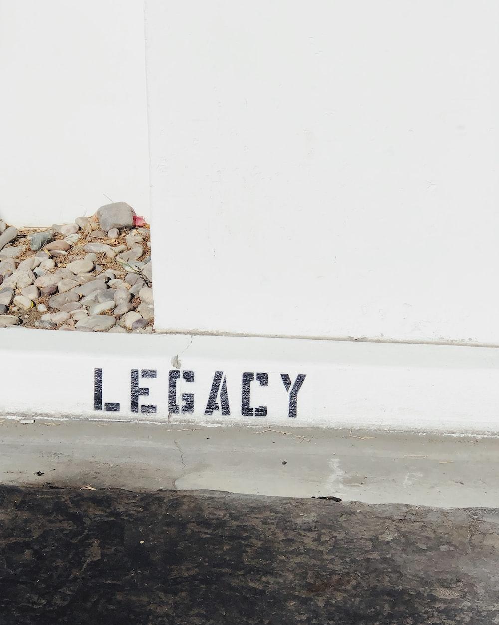 white and gray Legacy graffiti
