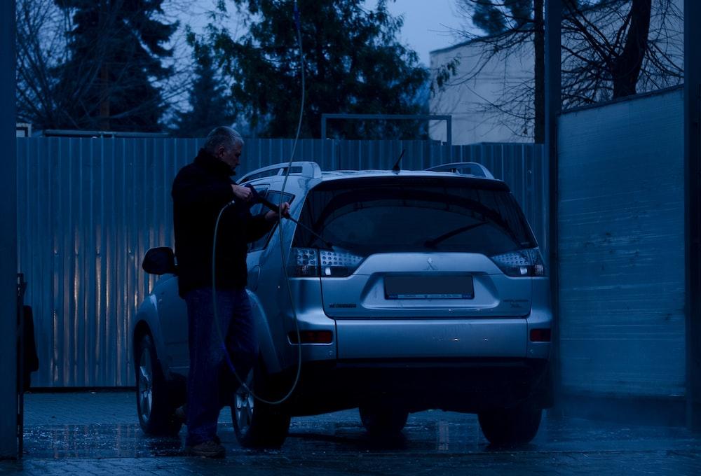 man about to have carwash on silver Mitsubishi vehicle