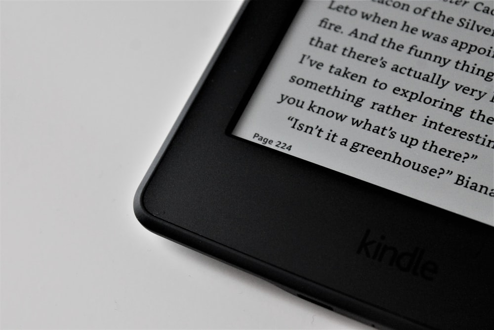 black Amazon Kindle e-book reader