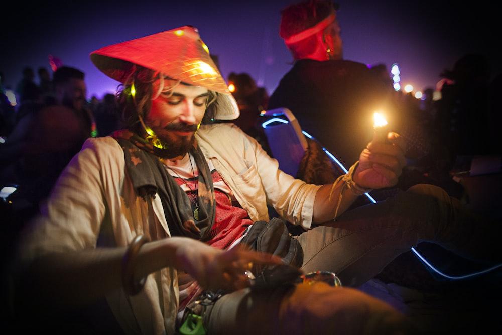 man holding turned-on lighter