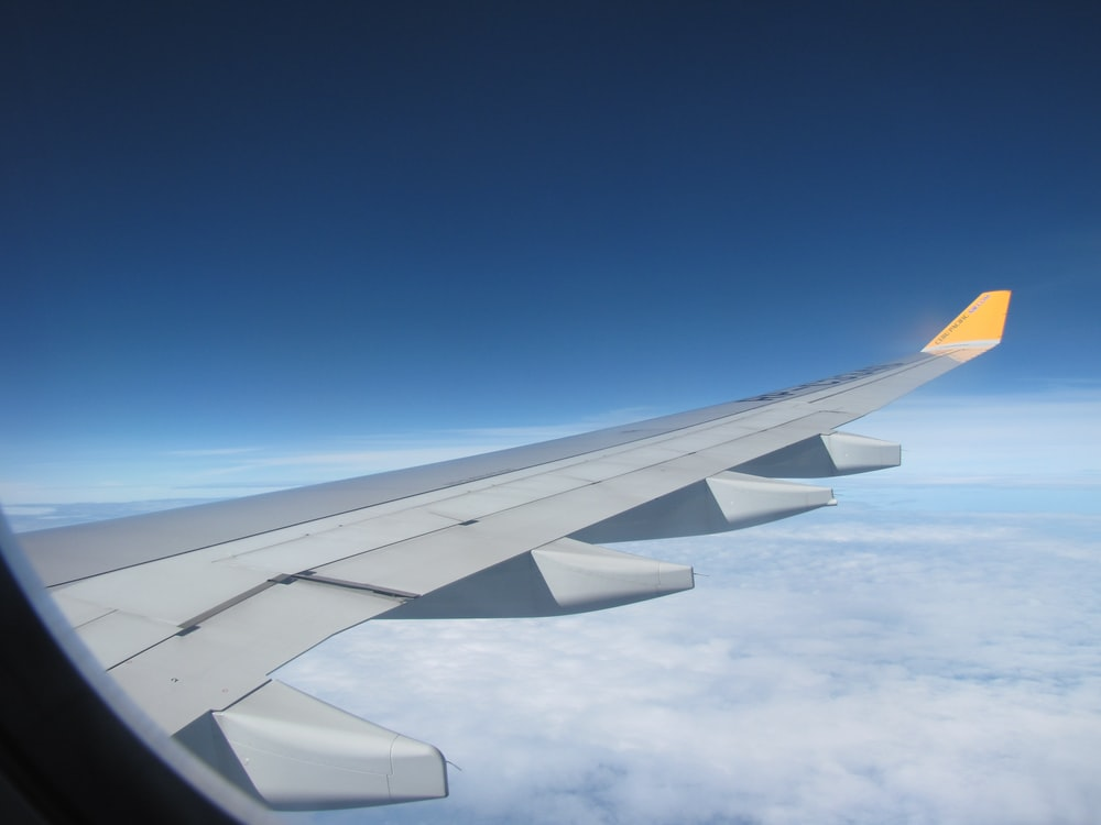 gray and white airplane window wing