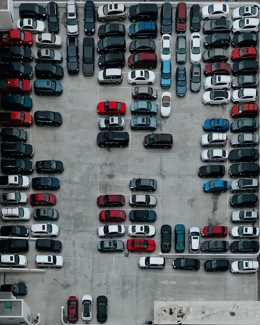 aerial photography of cars on parking lot